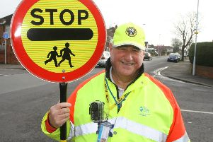 Worthing lollipop man Terry Rickards with his body worn camera