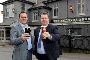 Andrew Gedge, left, is joined by Andy Tew, to toast the purchase of the iconic Bellevue Arms.