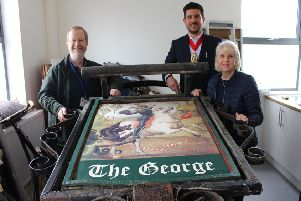 The Mayor of Crawley, Councillor Carlos Castro, was joined by Ron Goodall's daughter Diane West to present the sign to Crawley Museum