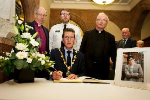 The Mayor of Derry, John Boyle, signing the Book of Condolence for Lyra McKee.