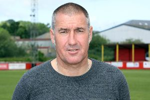 Banbury United manager Mike Ford has signed a new contract with the club