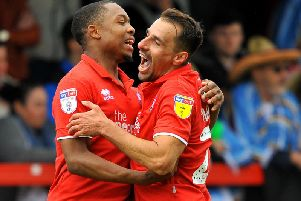 Scorers Ashley Nathaniel-George and Filipe Morais celebrate a Crawley Town goal against Tranmere Rovers.'Picture by Steve Robards