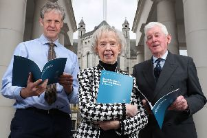Professor Duncan Morrow, Ulster University, Lady Moyra Quigley and Ronnie Kells, chair, Sir George Quigley Committee, with the report