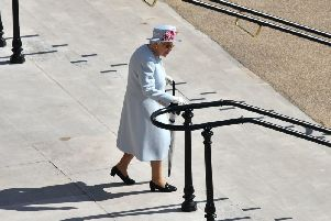 Queen Elizabeth II arrives for a Royal Garden Party at Buckingham Palace in London. Pic: Ben Stansall/PA Wire