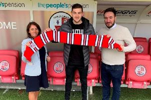 Crawley Town new signing Ashley Nadesan with operations director Kelly Derham and director of football Selim Gaygusuz. Picture courtesy of Crawley Town