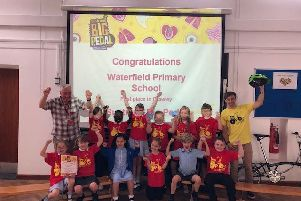 Pupils at Waterfield Primary School celebrate the award