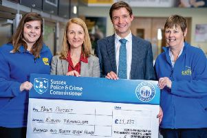 Sussex Police and Crime Commissioner Katy Bourne presenting a cheque to Cats Protection