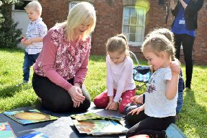 Manager Nikki Clark plays with pre-school children in the garden of Scalford Methodist Church, where the group has met for more than 40 years EMN-191207-161459001