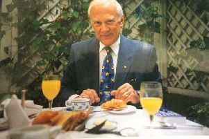 Astronaut Buzz Aldrin pictured at breakfast with Haywards Heath journalist Arnie Wilson SUS-190715-170616001