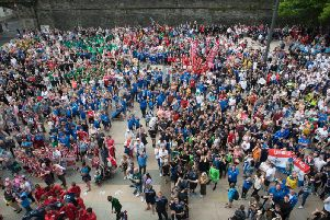 Players, managers, officials and supporters in the Guildhall during the O'Neills Foyle Cup parade.