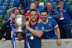 Linfield captain Jamie Mulgrew celebrates with some of the supporters following last season's Gibson Cup triumph. Pic by Pacemaker