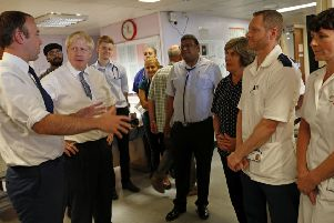 Prime Minister Boris Johnson (2nd left) and Matt Hancock, Secretary of State for Health and Social Care (left)  meet staff during a visit to Pilgrim Hospital in Boston, Lincolnshire, to announce the government's NHS spending pledge of 1.8 billion. Photo: Darren Staples/PA Wire EMN-190813-133103001