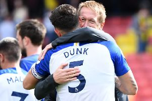Graham Potter hugs Lewis Dunk after victory against Watford (Getty)