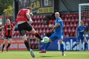 Billy Joe Burns fires Crusaders into a 2-0 lead over Dungannon Swifts. Pic by Pacemaker.