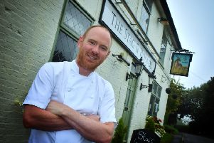 Dom Clarke outside The Stag and Hounds pub at Burrough on the Hill which he has taken over EMN-190916-174041001