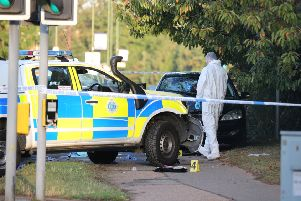 Forensic investigators at the scene in Littlehampton this morning