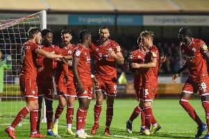 Reds celebrate Ferguson's strike. Picture by PW Sporting Photography