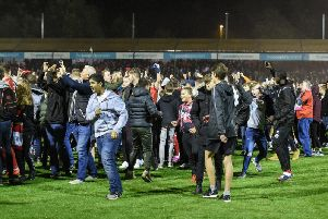 Crawley Town fans on the pitch after the Stoke City win