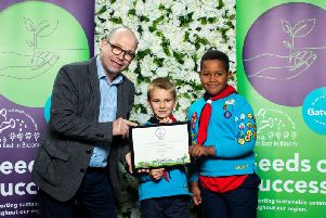 Presenter Joe Talbot hands over the award to members of the 7th Crawley Beavers