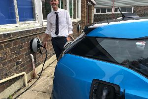 Matthew Andrews, deputy headteacher at Three Bridges Primary School, at one of the chargepoints