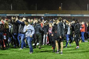 The fans on the pitch after the Stoke City win