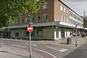 There are plans to convert office space above Lloyds Bank, Crawley, into eight flats. Image: Google Maps Street View
