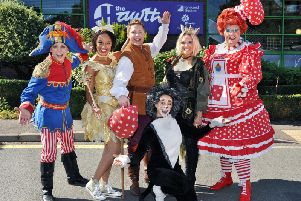 L-R Richard Franks (Billy), Gemma Hunt (Fairy Bowbells), David Ribi (Dick Whittington), Charlie Brooks (Queen Rat), Michael J Batchelor (Sarah the Cook),Harri Nichols (Tommy the Cat)