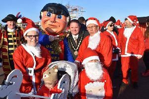 Mayor of Skegness Coun Mark Dannatt with the Jolly Fisherman and Town Crier Steve O'Dare at the Santa Fun Run in Skegness. Photo: Barry Robinson.
