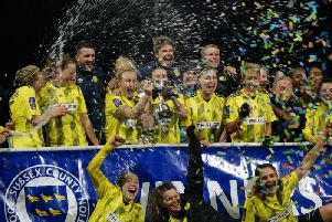 Wasps are drowned in champagne and confetti as they lift the trophy. Picture by Alan Sillwood-Brown