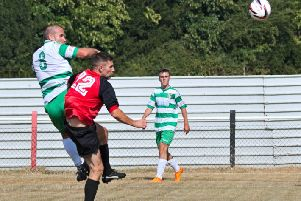 Greg Williams heads United level during Saturday's friendly with Tring Athletic. Picture: Mike Snell