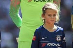 Esma Finnegan with Chelsea goalkeeper Willy Caballero ahead of the Community Shield