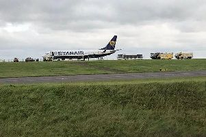 The damaged plane after it had touched down at East Midlands Airport