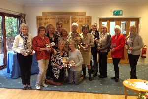 Beryl Wood (Senior Ladies Handicap Cup); Gill McDougall (Croxford Cup); Val Berry (Lucking Cup and Bridgestone Medal); Lesley Brazier (Lady of the Year); Ladies Captain Carmen White Lawes; Alison Shirville (Grannies Salver); Farida Cerosio (Summer Eclectic Bowl, Cherie James Birdies award); Lesley Bednarek (Senior Ladies championship, Challenge Cup and Foursomes Cup ); Elaine Powell (Foursomes Cup); Joyce Young (Winter Eclectic); Janice Hintner (nine hole Merit Award); Front kneeling: Outgoing Captain Patti Marriott and Vicky Pratt who won the Buckmaster Salver.