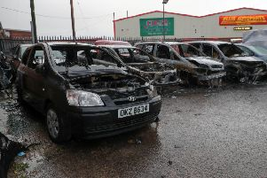 Damaged cars following an arson attack at a garage in the Woodburn Road area of Carrickfergus. ''Picture: PressEye