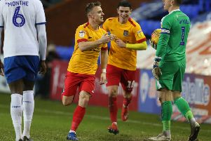 Sam Hoskins celebrates his second goal at Tranmere on Tuesday (Picture: Pete Norton)