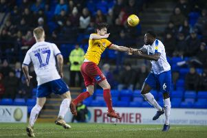 Ash Taylor heads away the danger