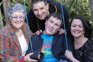 Lloyd (centre) with grandma Irene, dad Stuart and mum Julie.