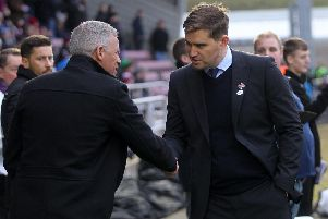 Grimsby boss Michael Jolley shakes hands with Cobblers manager Keith Curle ahead of the 2-2 draw between the sides in November