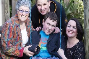 Julie Young (right) wants to know why her son Lloyd (centre) cannot access a medical cannabis prescription.