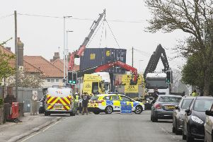 Workers from Storage on Site battle to stabilise the stricken crane SUS-190417-153939001