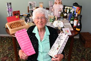 Joyce Taylor at her Purbrook home with some of the prizes that have been donated for her 90th birthday raffle. Picture: Malcolm Wells (190610-2148)