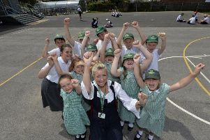 Head teacher Claire Martin-O'Donoghue and children celebrating Polegate School achieving flagship inclusion status (Photo by Jon Rigby)