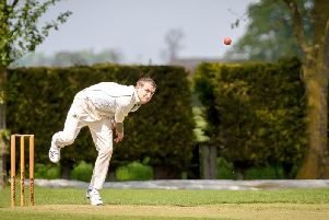 Ben Hollis - pictured bowling earlier this season - top scored for the first team on Saturday with 24