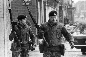 1972:  Armed British soldiers on patrol in Lisbon Street, Belfast, during the Official IRA's unconditional ceasefire.  (Photo by Evening Standard/Getty Images)