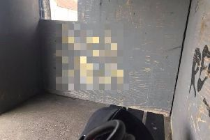 An abusive phrase, which has been pixelated to avoid offence, was daubed on the wall of the bus shelter. Picture courtesy of Jonathan Swain