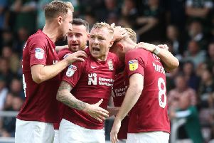 On the spot: Cobblers celebrate Ryan Watson's successful penalty. Pictures: Pete Norton
