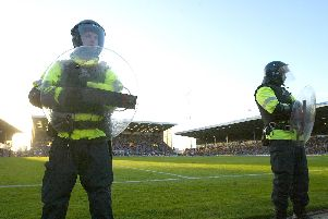 Riot police line the ground during the FA Barclaycard Premiership match between Portsmouth and Southampton at Fratton Park on March 21, 2004 in Portsmouth, England.   (Photo by Mike Hewitt/Getty Images)