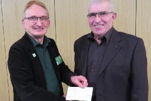Andy Bower from Warwick District Foodbank receiving a cheque from Warwick Rotary President David Brain. Photo supplied.