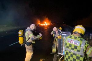 Firefighters deal with the blazing HGV on the A43