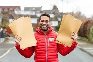 Postcode Lottery ambassador Danyl Johnson delivers the good news to two villagers in Ecton